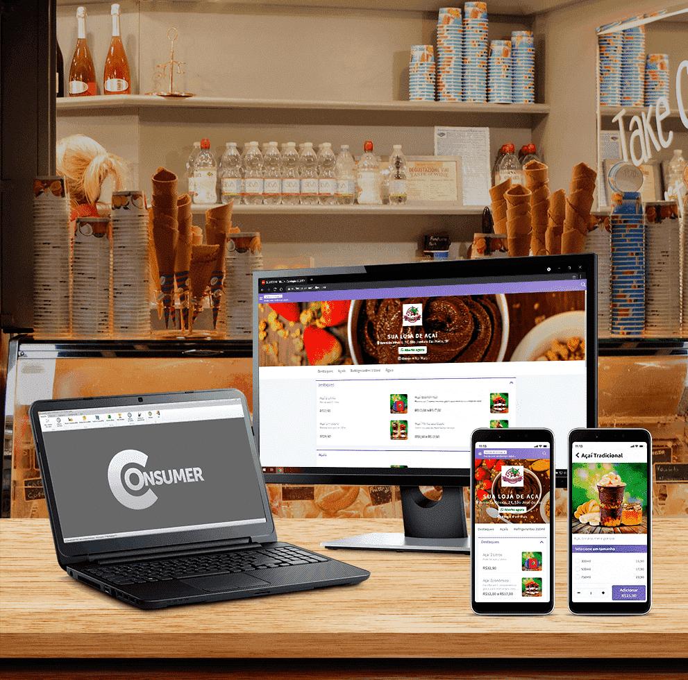 notebook com o sistema consumer, monitor com o site Delivery  e Aplicativo no celular.